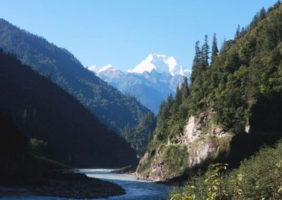 Photo of stream winding between mountains
